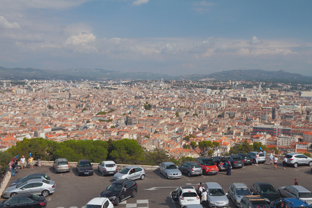 Marseille, France - Sep 30, 2018: Automobile parking and city in valley
