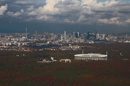 Forest area, stadium and city, aerial photograph. Frankfurt am Main, Germany