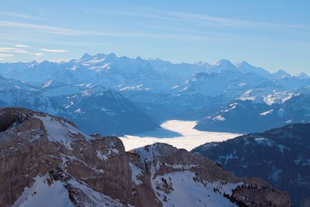 Mountains and overcast over the lake in the Alps. Pilatus, Lucerne, Switzerland Stok Fotoğraf