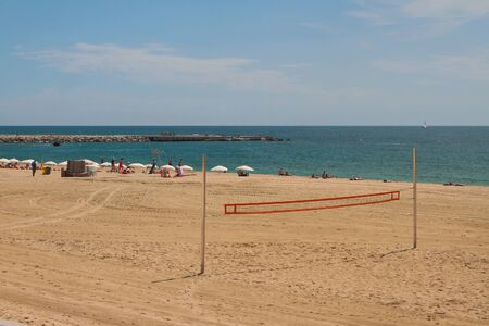 Barcelona, Spain - Jun 13, 2019: Volleyball net, beach and sea Reklamní fotografie