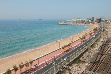 Sea, sandy beach and highway along coastline. Tarragona, Spain Reklamní fotografie
