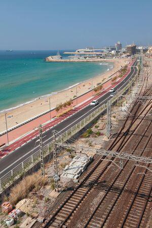 Beach, highway and railroad along sea coast. Tarragona, Spain