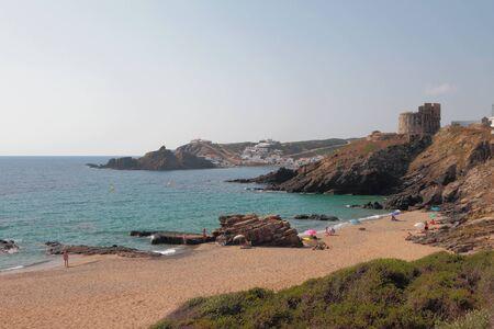 Sandy beach and sea bay. Cala Mesquida, Menorca, Spain Stok Fotoğraf