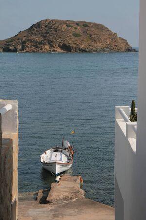Cala Mesquida, Menorca, Spain - Jul 05, 2019: Fishing boat and sea bay Stok Fotoğraf