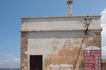 Stone wall and index of sights. Portoferraio, Elba Island, Italy Stok Fotoğraf