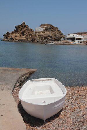 Boat on coast of sea bay. Cala Mesquida, Menorca, Spain