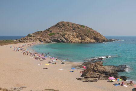 Sandy beach on coast of sea gulf. Cala Mesquida, Menorca, Spain