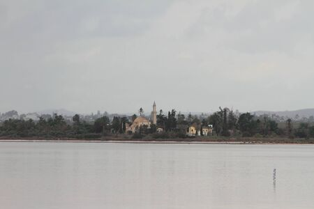 Salty lake and mosque on shore. Larnaca, Cyprus