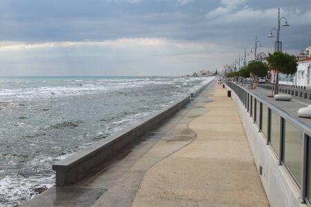 Storming sea and city embankment. Larnaca, Cyprus