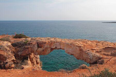 Stone arch and sea. Cape Greko, Agia Napa, Cyprus