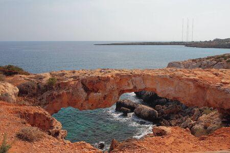 Stone arch on sea coast. Cape Greco, Aya Napa, Cyprus Stok Fotoğraf