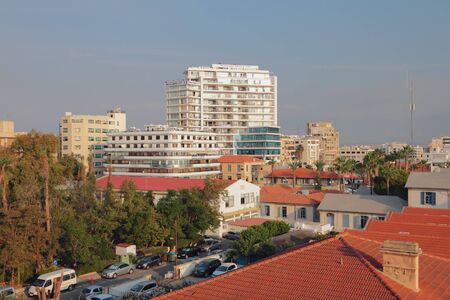 Larnaca, Cyprus - Oct 23, 2019: Tile roofs and town