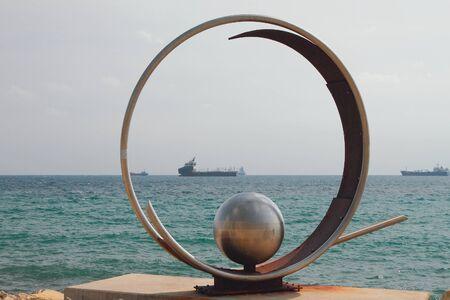 Limassol, Cyprus - Oct 23, 2019: Composition from metal on embankment Editöryel