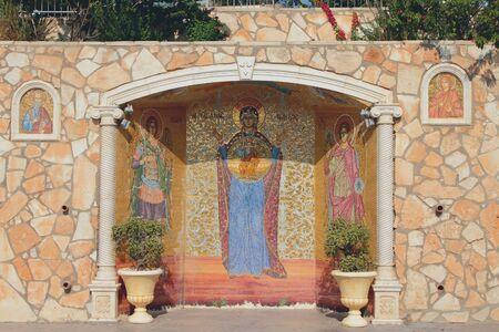 Painting mosaic on monastery walls. Agia Napa, Cyprus