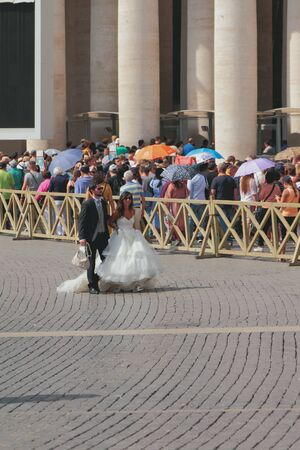 Rome, Italy - Sep 18, 2019: Wedding couple on city square