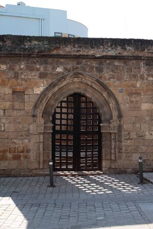 Ancient gate in stone wall. Nicosia, Cyprus