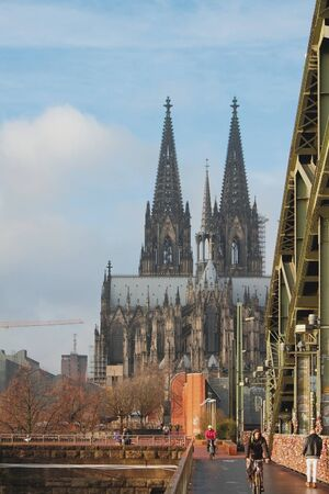 Cologne, Germany- Jan 07, 2020: Bicycle-pedestrian bridge and cathedral Stok Fotoğraf