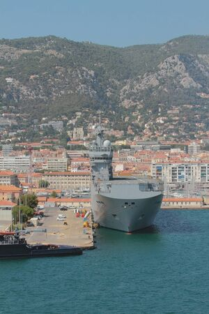 Warship in port parking lot. Toulon france
