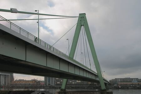 Cable-stayed double-span bridge over river. Cologne, Germany