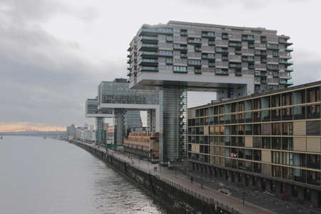 River and modern buildings on embankment. Cologne, Germany