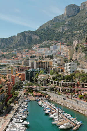 Yacht parking in sea bay, city and mountains. Monte Carlo, Monaco