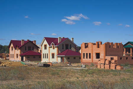 Construction of cottage village in field. Kazan, Russia