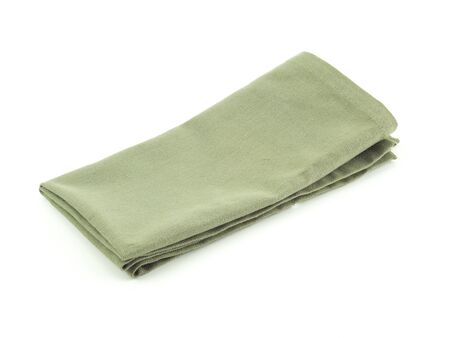Green napkin or kitchen towel isolated on a white background.