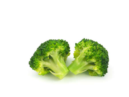 Close up broccoli steamed cut into pieces isolated on a white background. Helps with weight loss, reduces cholesterol and helps fight cancer.