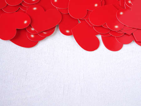 Red heart on white wooden background. Concept love, greeting card, banner, poster. Colse up with copy space for text.