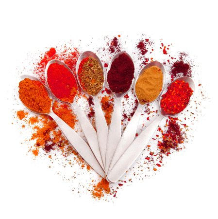 A spoonful of spoons with spices and ingredients Stock Photo