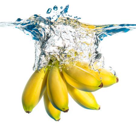 fresh bananas falling in water