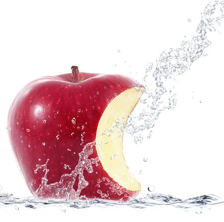 fresh apple falling in water Stock Photo
