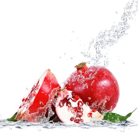 fresh pomegranate falling in water Standard-Bild