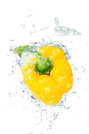 fresh peppers falling in pure water