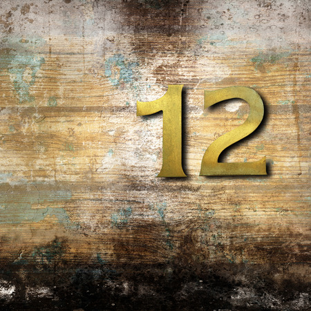 Number twelve on a wooden background