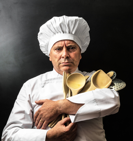 Crazy cook with his wood spoons Stock Photo