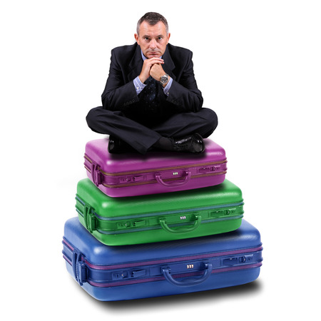market bottom: Manager sitting on suitcases