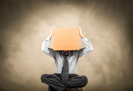business man with a carton box on the head