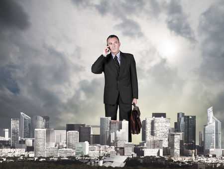 giant business man in the city Stock Photo
