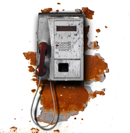 Old public phone on metal background