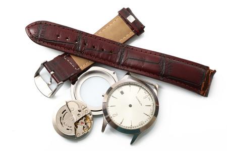 broken watch on white background