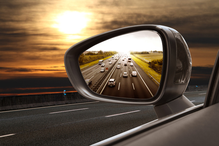 Reflected road in rearview mirror