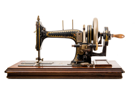 old sewing machine on white background