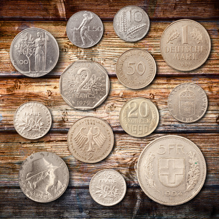 metal coins on wood background
