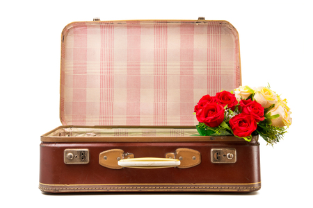 Old suitcase on white background with flowers Stock Photo