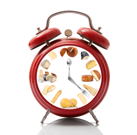 isolated alarm clock with cheese dial on white background