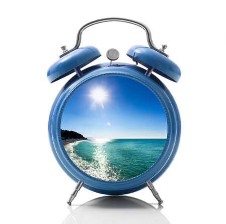 isolated alarm clock with beach dial on white background Stock Photo