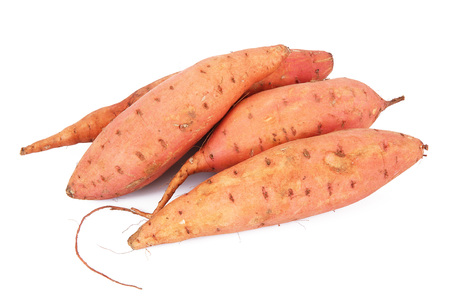 a fresh sweet potatoes on white background Banco de Imagens