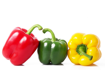 fresh hot peppers on white background