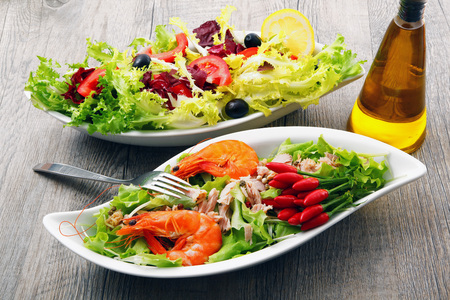 two salad on old wooden table